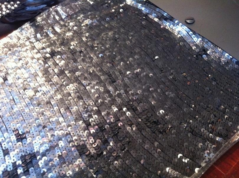 My second favourite - this is a matt black sequinned fabric with the sequins sewn in the row. Given the sample instore has packing tape down the cut sides, I'm wary of this one because those sequins would so easily become undone. during cutting/sewing. Wide seam allowances would definitely be required.