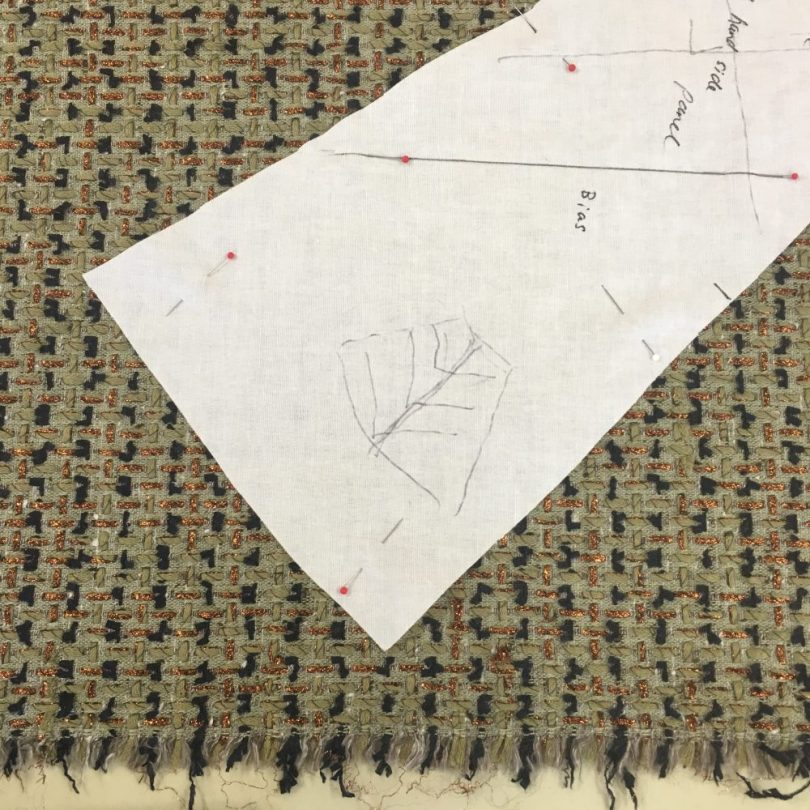 Ros is sewing with a really fascinating fabric in an olive green that has Navy and copper highlights. She's also having a bias panel down the sides of her jacket - which entails an epic amount of quilting! Ros is two sizes different across her hips to her upper torso, and this additional bias panel does beautiful justice to her curves. Check out her smile here!